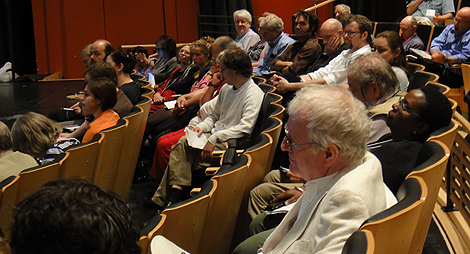 Conference participants listening to reports from the second session on the second theme
