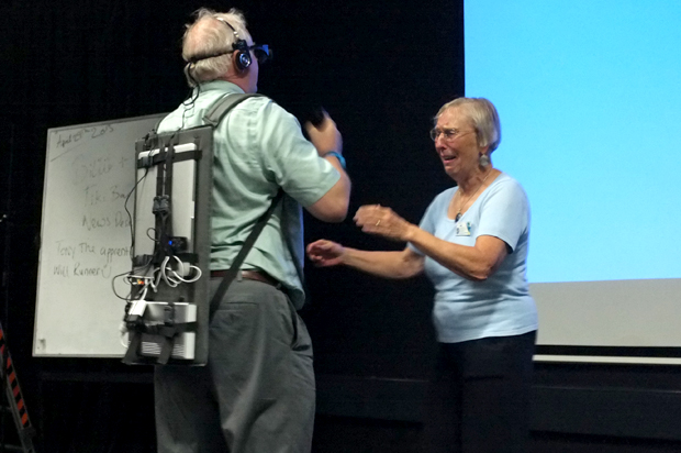 Peter Tuddenham and Pille Bunell experiencing Jennifer Kanary's Wearable Psychosis Simulator